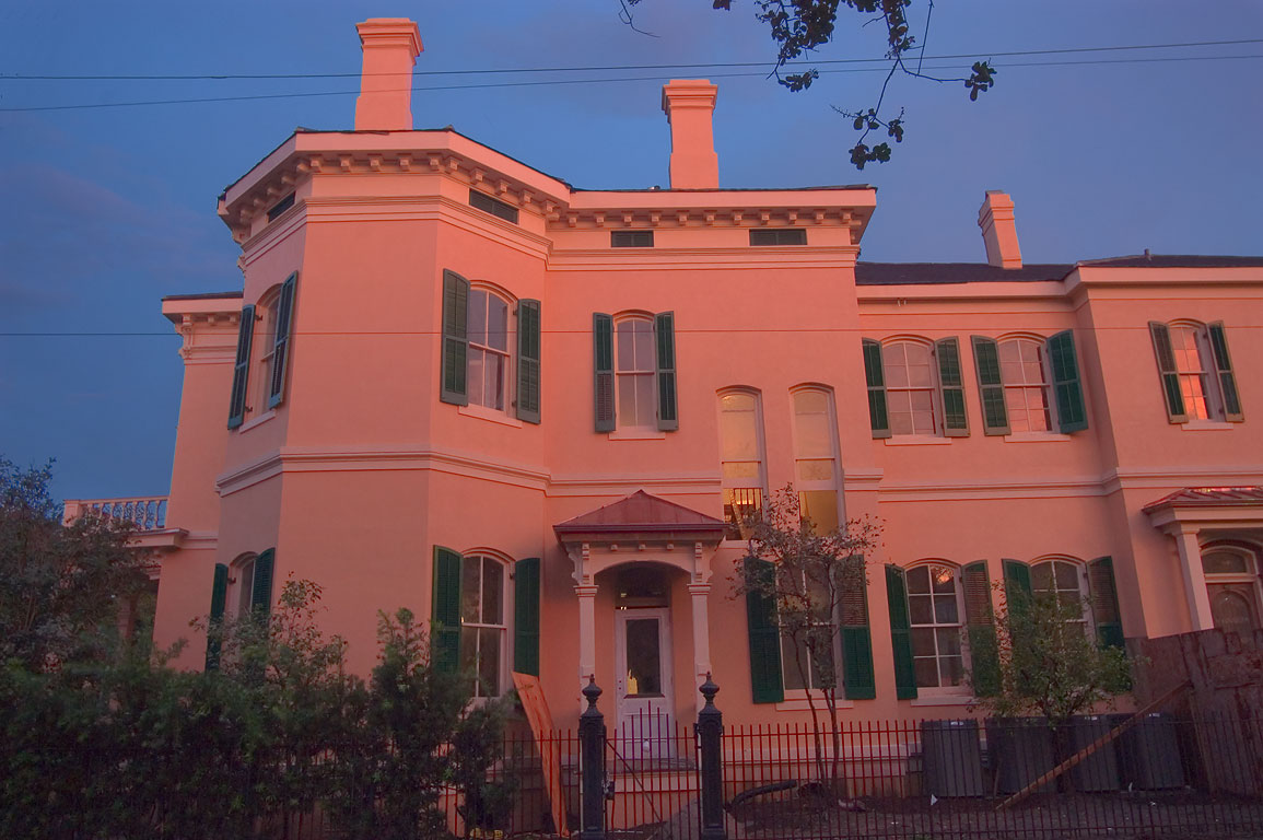 Camp St. at a corner of Second St. in Garden District at sunset. New Orleans, Louisiana