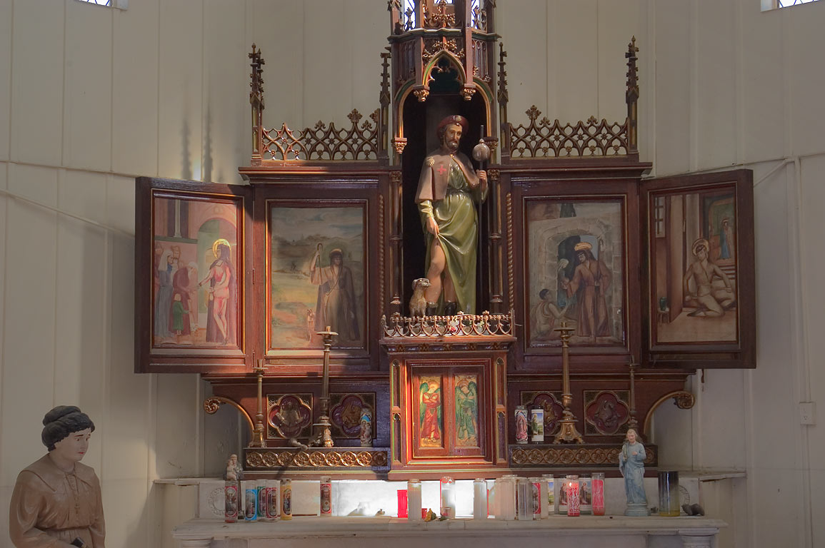 An altar with a statue of St.Roch in Chapel of St.Roch Cemetery. New Orleans, Louisiana