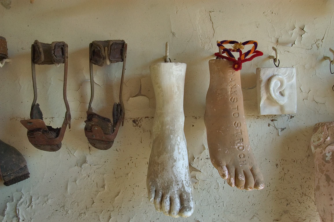 Replicas of feet and handicapped braces in ex...Roch Cemetery. New Orleans, Louisiana