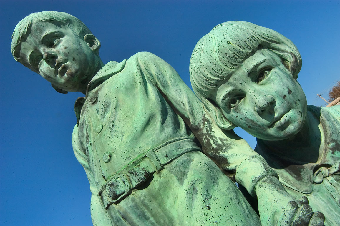 Bronze sculptures of children on a tomb of...Cemetery. New Orleans, Louisiana