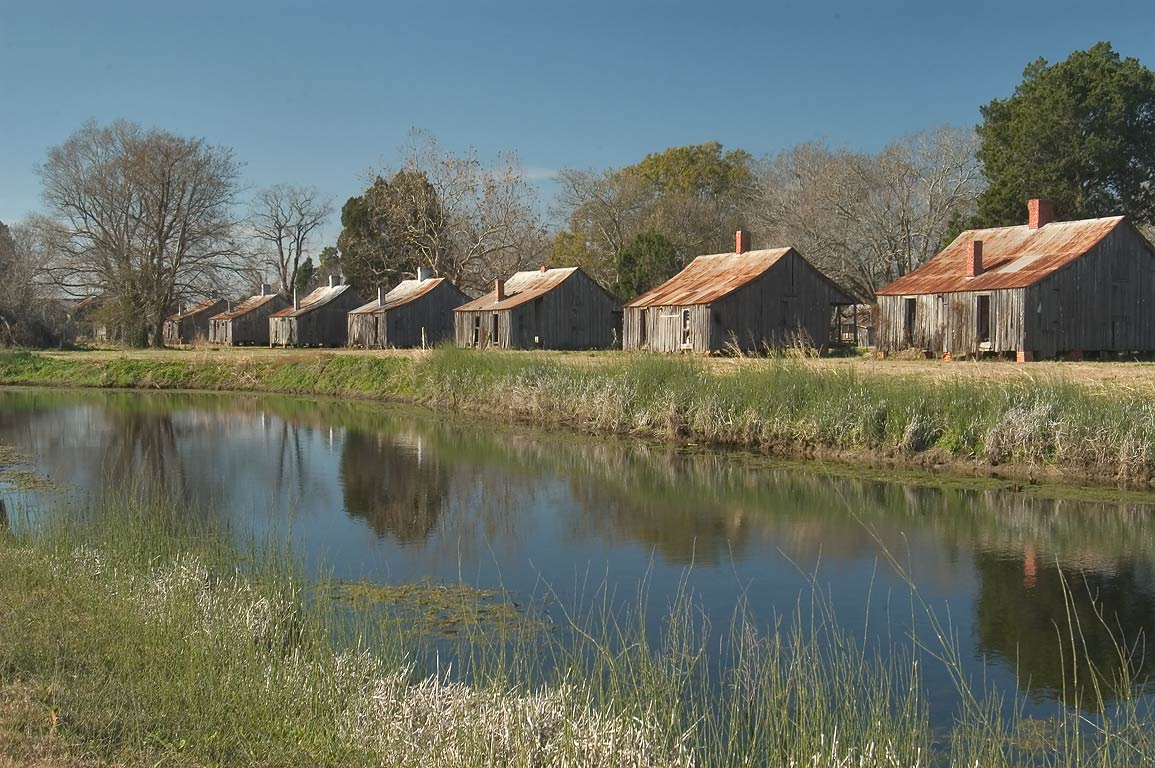 Cabins of workers along a pond in Laurel Valley. Thibodaux, Louisiana