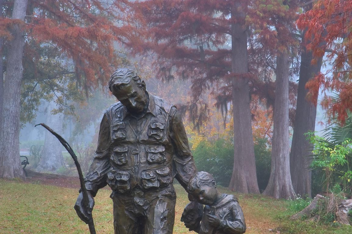 A public statue in north end of Audubon Park in fog. New Orleans, Louisiana