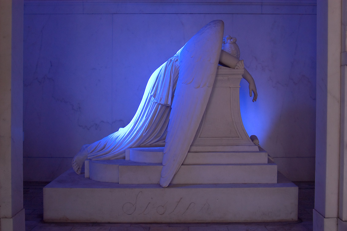 Blue weeping angel in a tomb of Chapman H. Hyams...Cemetery. New Orleans, Louisiana
