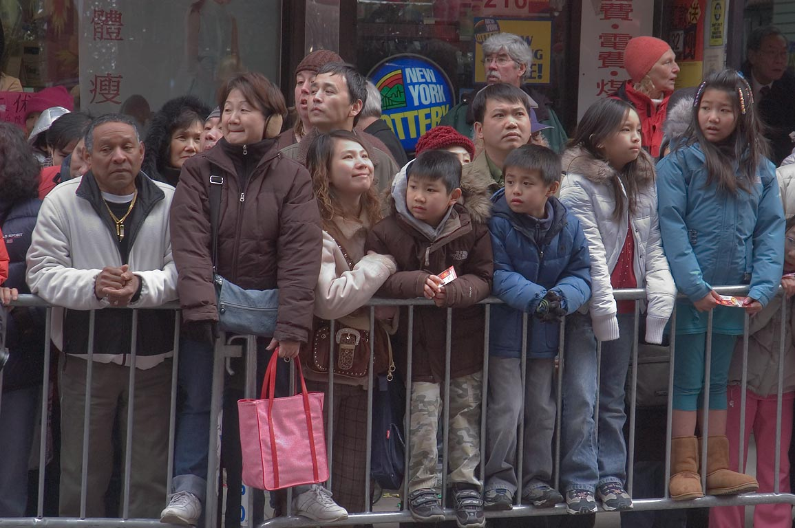 Families at Chinese Lunar New Year Parade on Allen Street in Chinatown. New York City