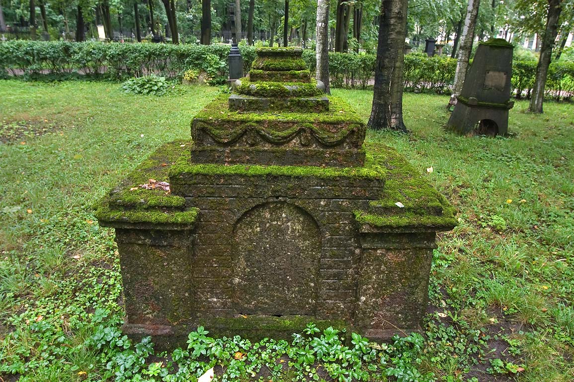 Mossy tomb in Literatorskiye Mostki section of Volkovo Cemetery. St.Petersburg, Russia