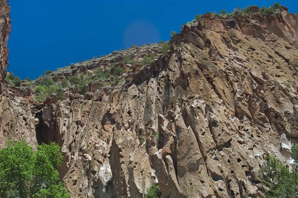 Walls of Frijoles Canyon behind Visitor Center in...Monument. New Mexico, near Los Alamos