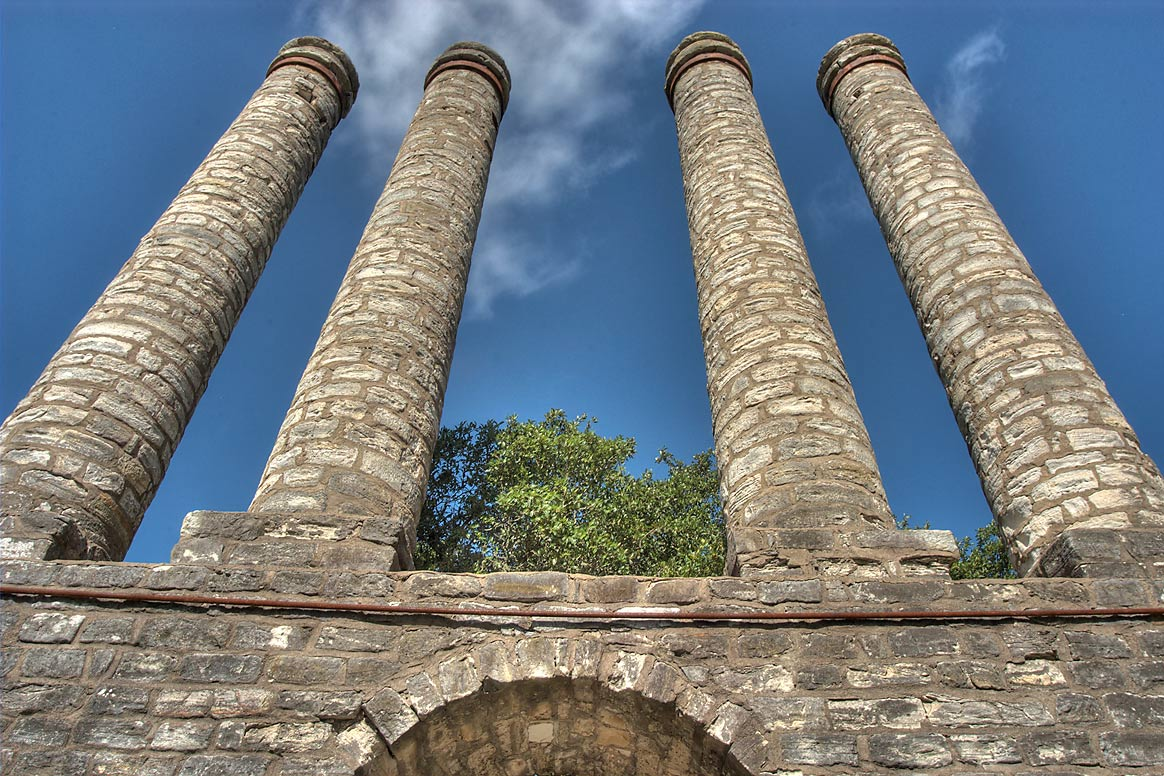 Four tall stone columns, ruins of front facade of...University Park. Independence, Texas