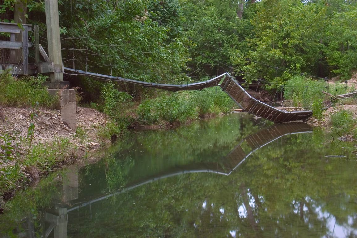 Steel cable suspension bridge downstream from the...Hollow Lake. Belton-Killeen, Texas