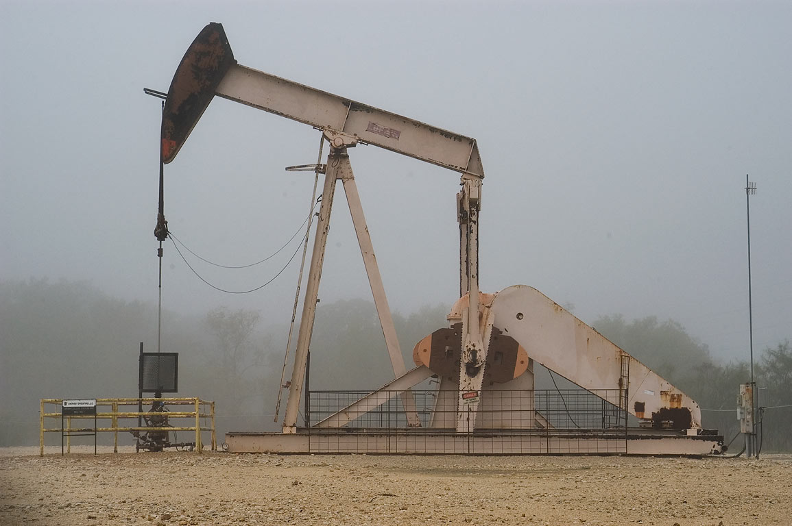 Oil well near Earl Rudder Freeway in fog. Bryan-College Station, Texas
