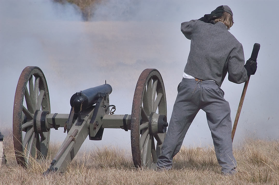 Actor operating a cannon of Confederate artillery...at Lake Madison. Madisonville, Texas
