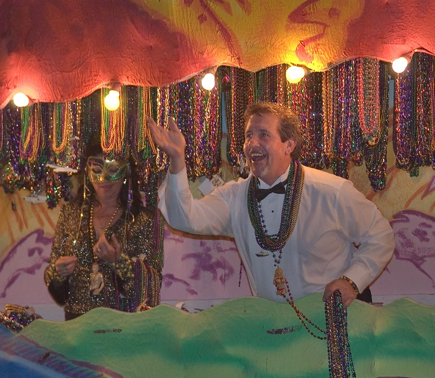Throwing beads from Mardi Gras float during...Blvd. near 19th St.. Galveston, Texas