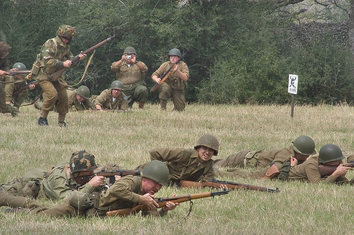 Infantry on a battlefield at WWII re-enactment in...American GI. College Station, Texas