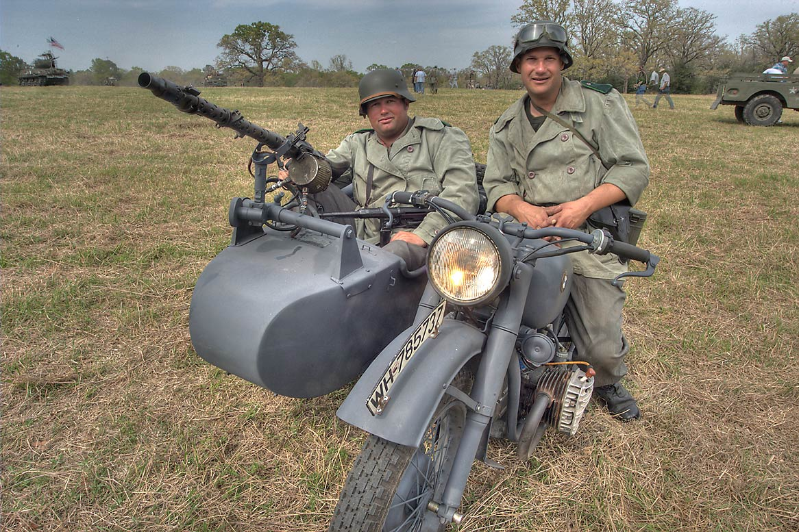 Actors on a motorcycle at WWII re-enactment in...American GI. College Station, Texas