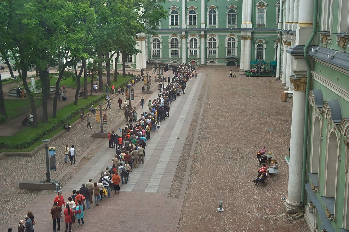 Long line of tourists standing in courtyard of...Museum. St.Petersburg, Russia