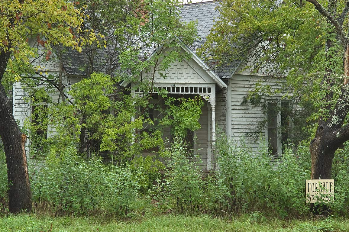 Overgrown mansion at a corner of Kezee and China streets. Calvert, Texas