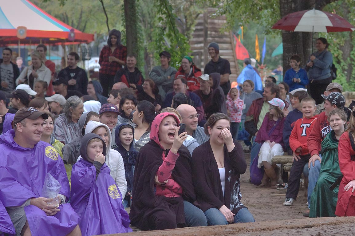 Spectators watching mud show at Texas Renaissance Festival. Plantersville, Texas