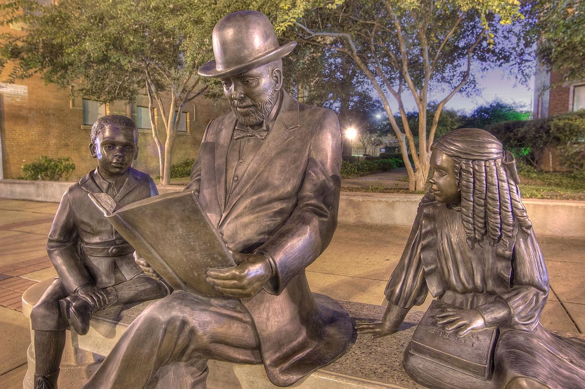 Public statue in front of a library on Main St. in downtown Bryan. Texas
