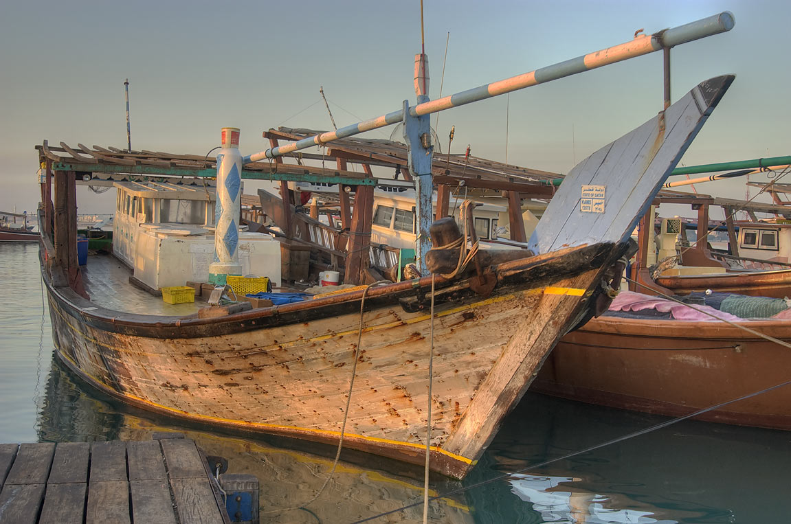 Dhow fishing boats at sunrise in harbor of Al Wakra, south from Doha. Qatar