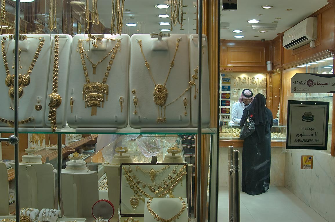 Woman in black shopping in Gold Souq (market). Doha, Qatar