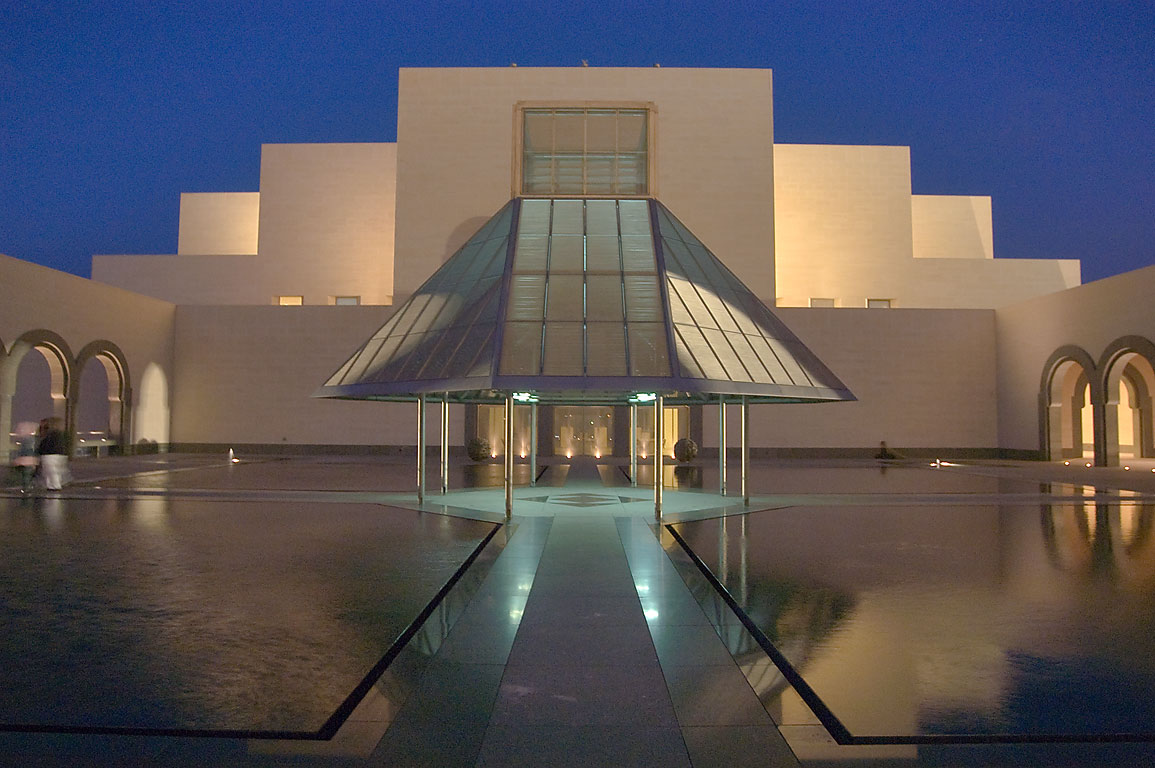Fountain courtyard in Museum of Islamic Art at dusk. Doha, Qatar