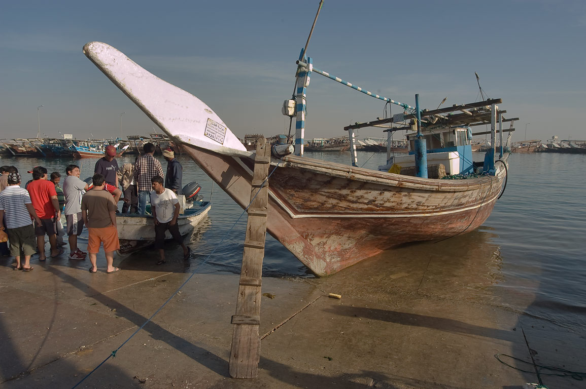 Selling fish from a boat in dhow harbor. Al Khor, Qatar