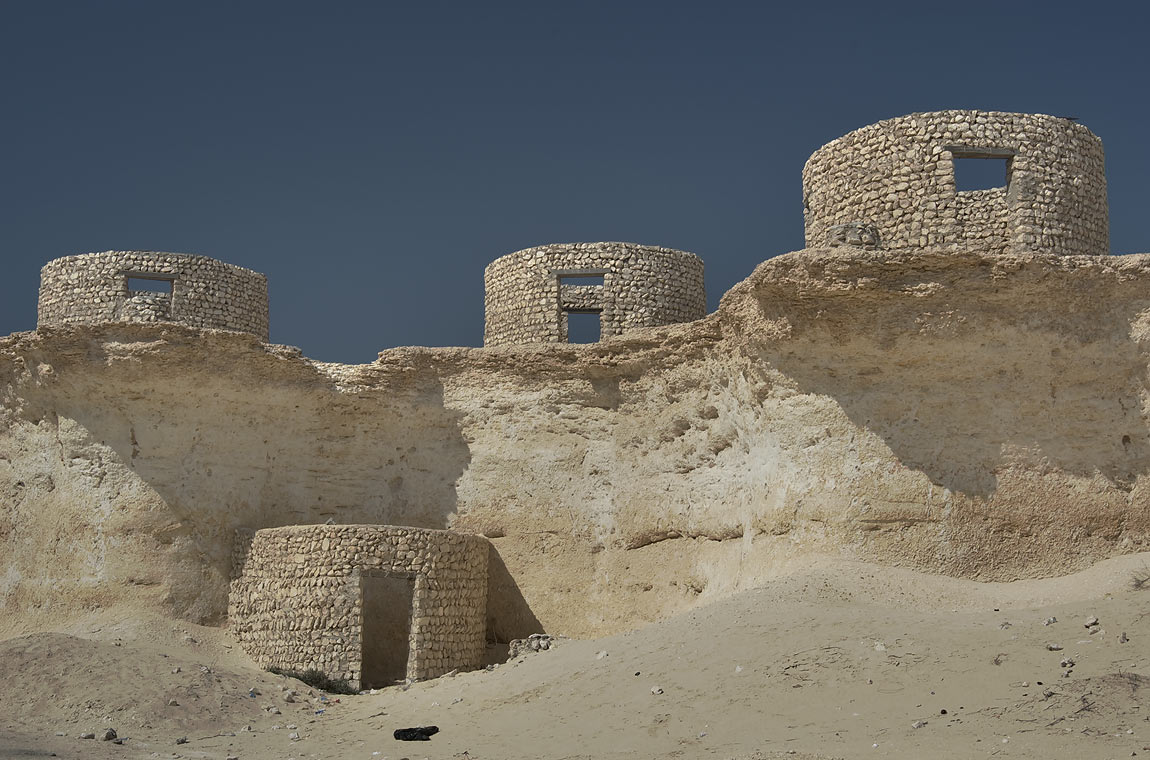 Group of circular stone huts in a ravine...area, north from Zekreet. Qatar
