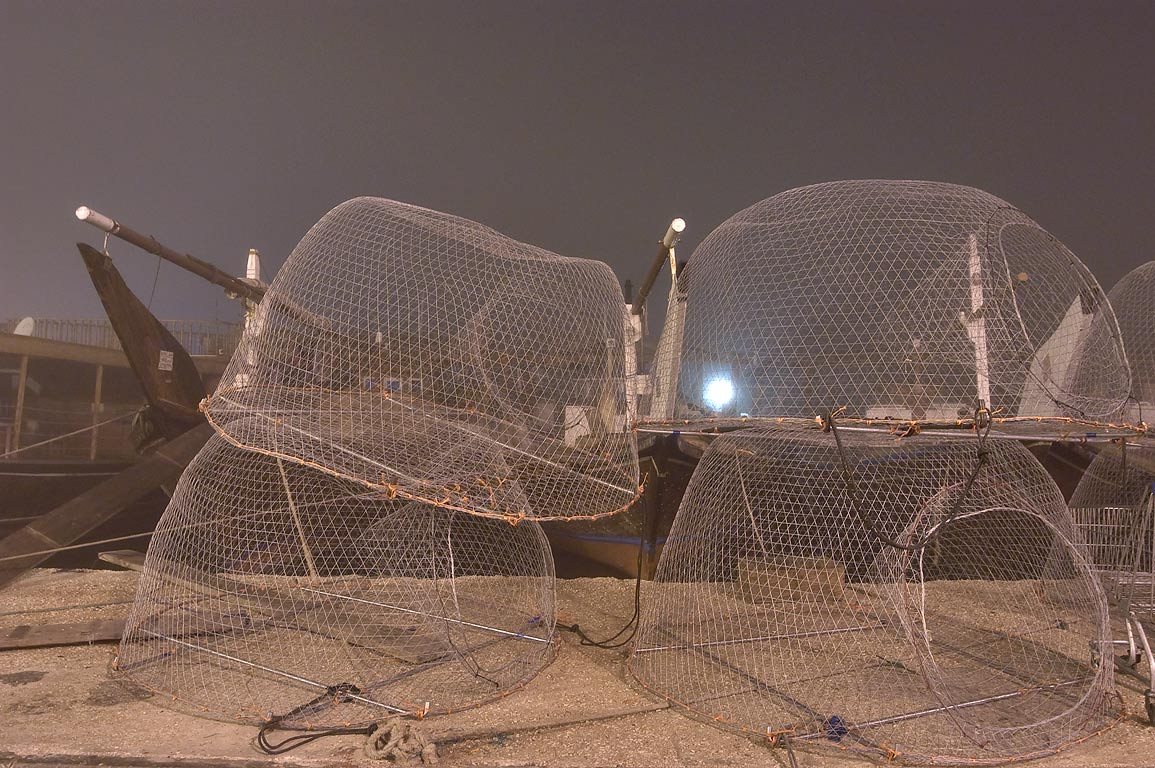 Domed wire fish traps (local name gargoor) in dhow port at morning. Doha, Qatar