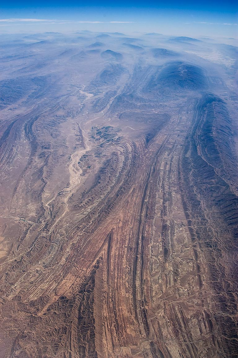 Geological folds near a village of Kurdeh (in the...plane from Doha, Qatar to Houston, TX