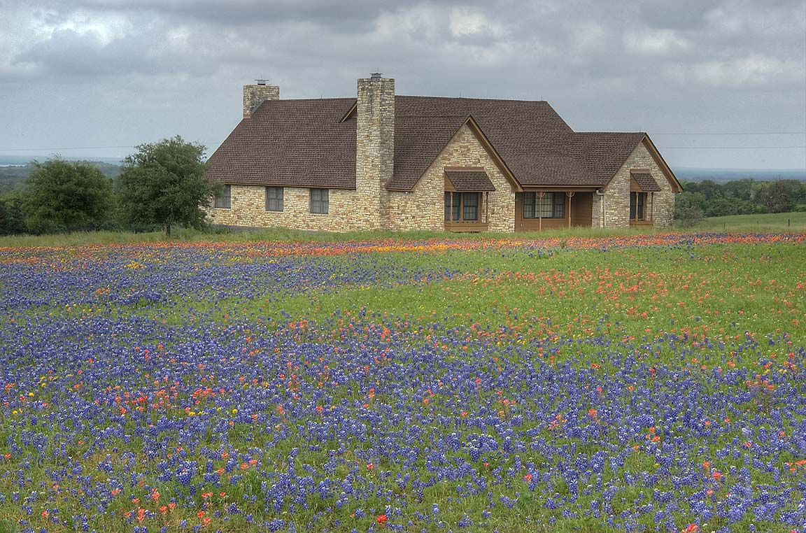 Stone house in bluebonnets at 3684 Rd. 390 west from Gay Hill. Texas