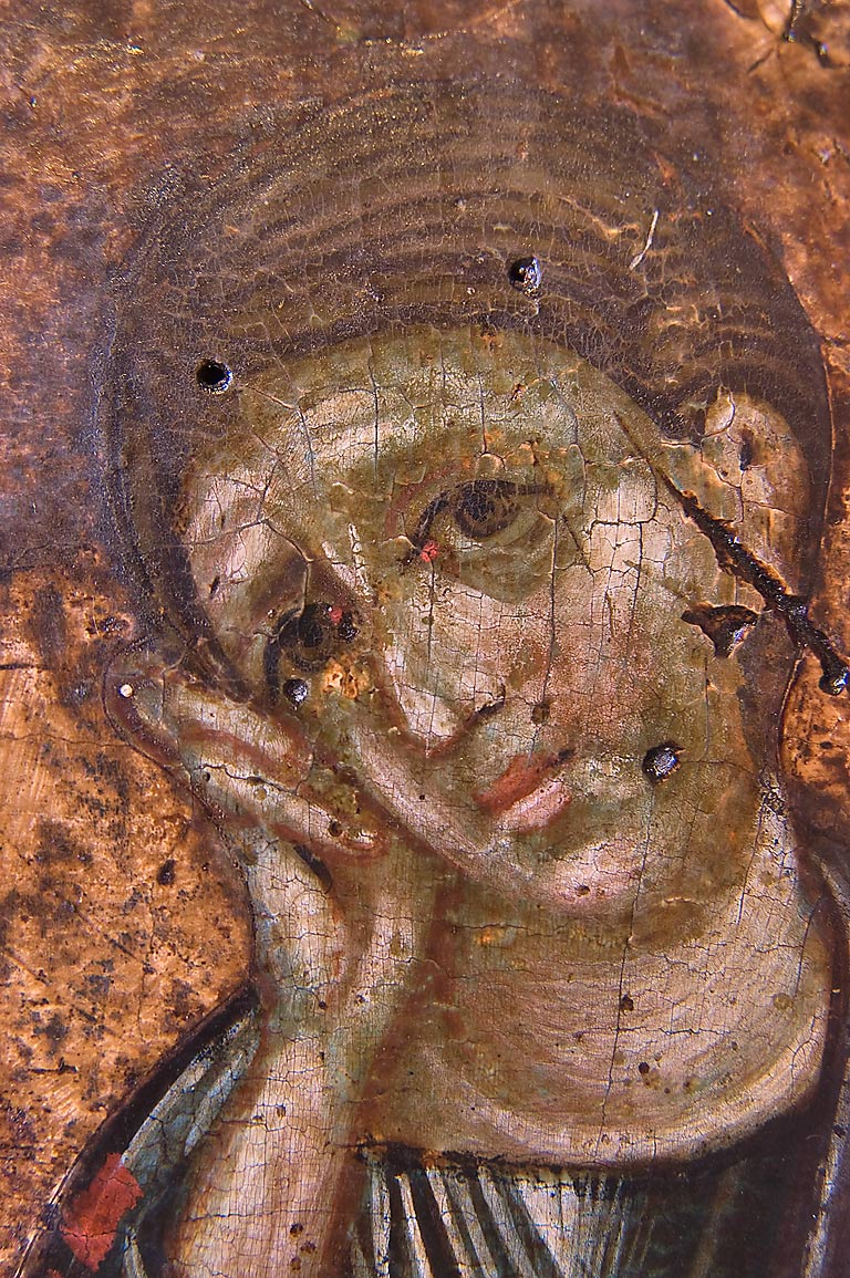 Details of a woman's head on a painting in Hermitage Museum. St.Petersburg, Russia