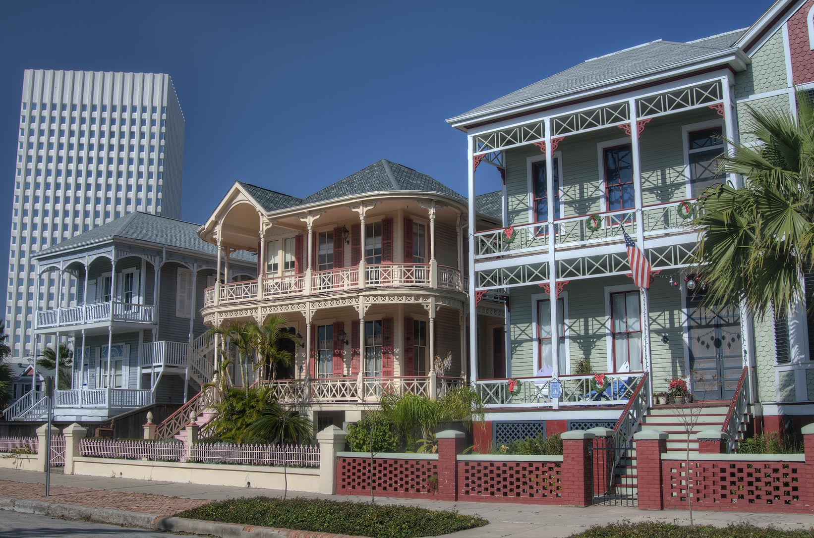 Postoffice St. in East End Historic District...Tower in foreground. Galveston, Texas