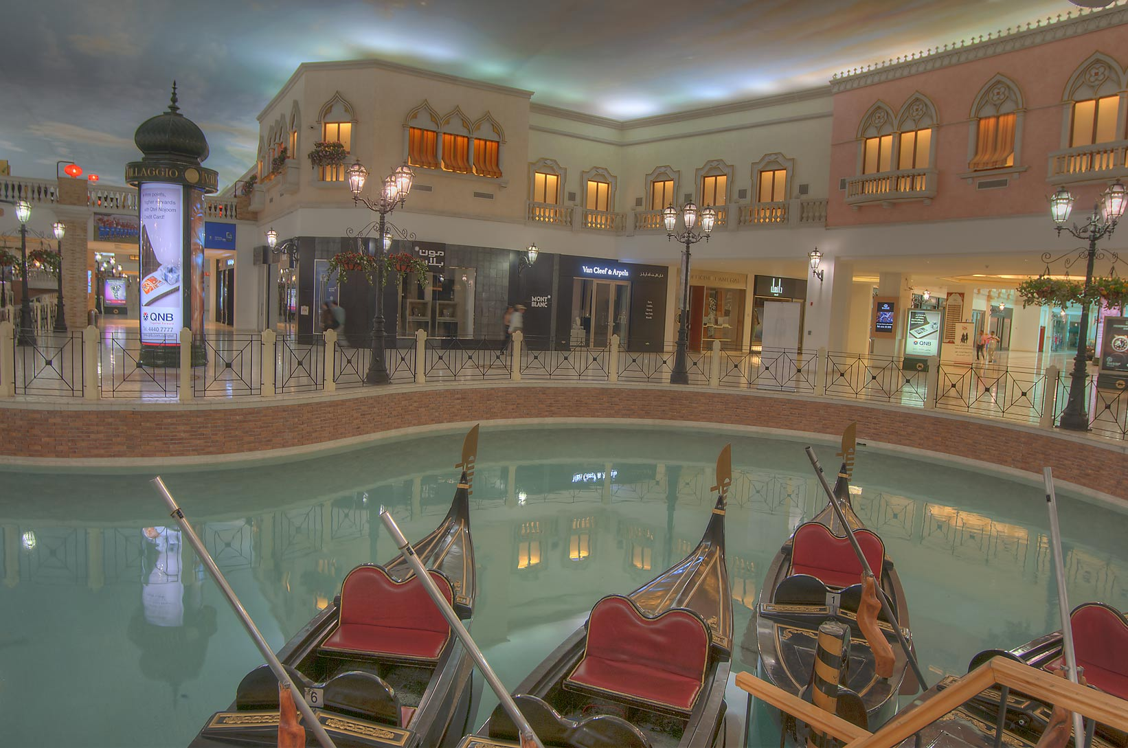 Gondola boats in a canal in Villagio shopping mall in Aspire Zone. Doha, Qatar