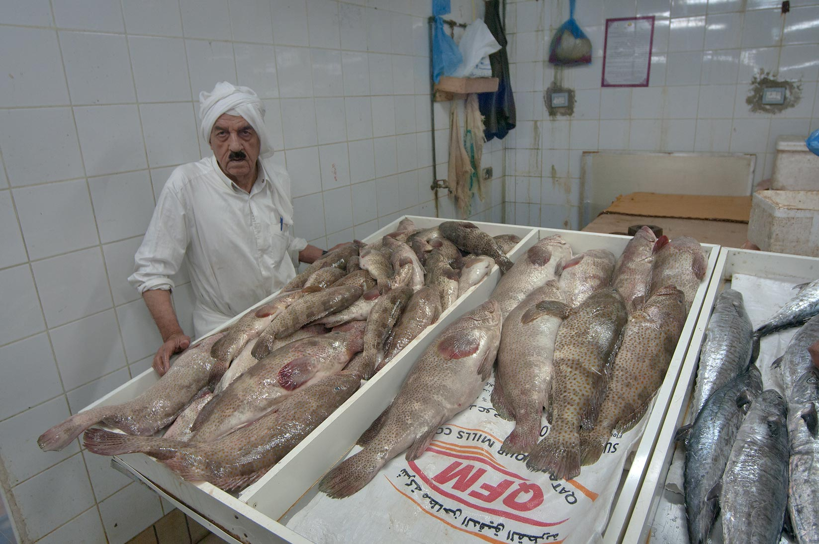 Vendor at fish stall in Central Fish Market. Doha, Qatar