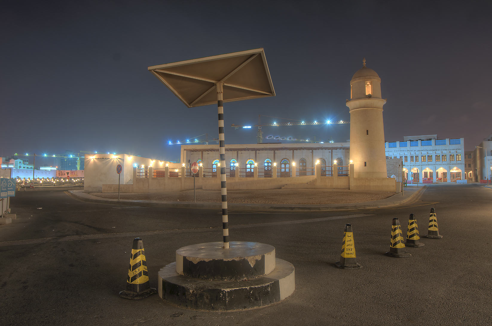 Area of Souq Waqif Mosque at early morning, with...stand in foreground. Doha, Qatar