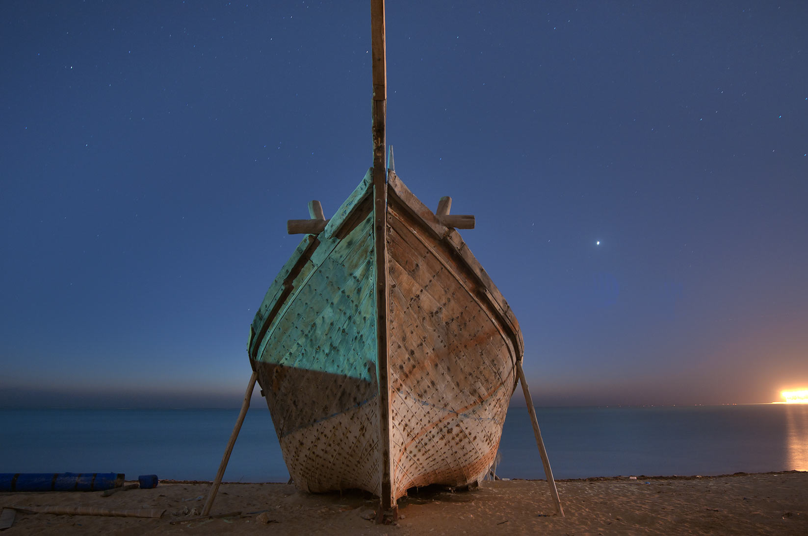 Hull of a beached dhow boat at early morning. Al Wakrah, Qatar