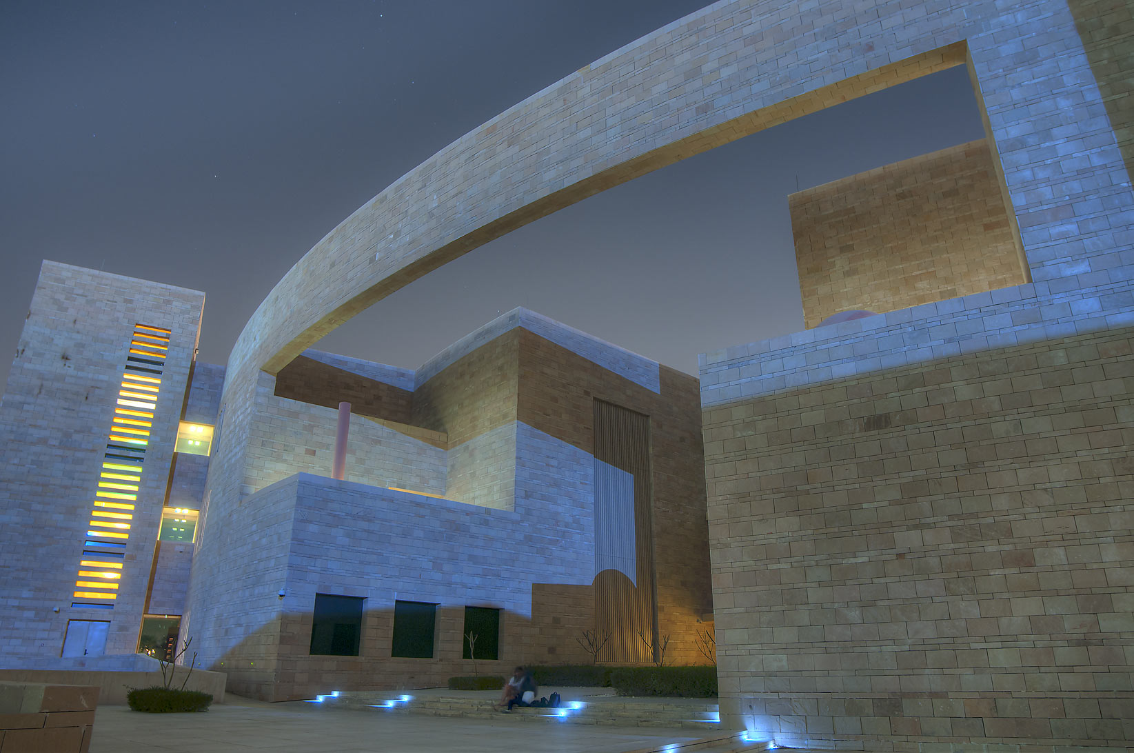 Arch of Carnegie Mellon University in Education City at moonlight. Doha, Qatar