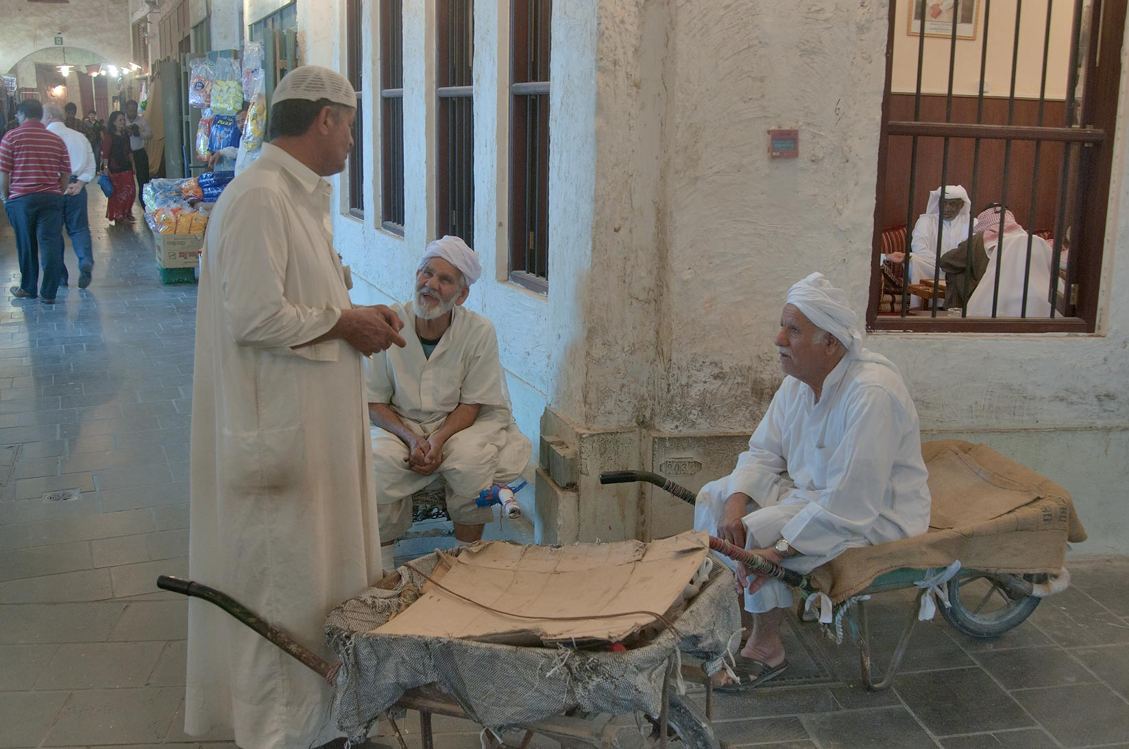 Chatting at a corner in Souq Waqif (Old Market). Doha, Qatar