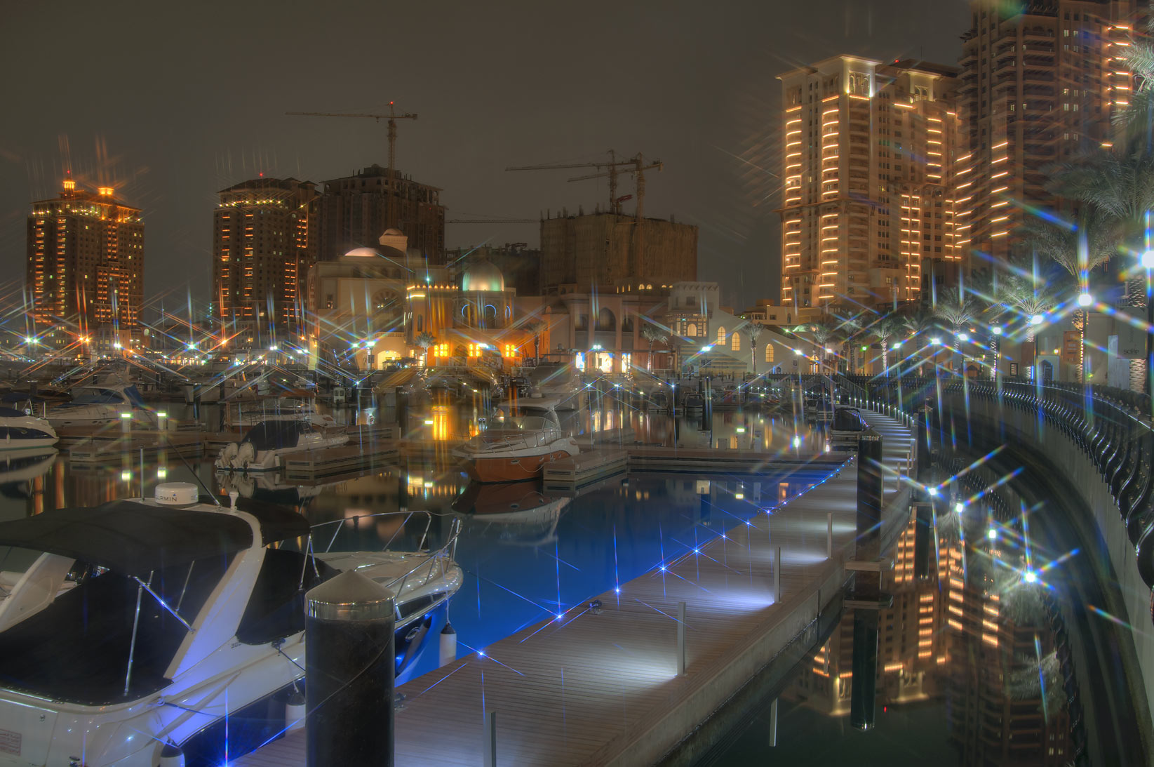 Evening lights of marina of Porto Arabia in Pearl Qatar development. Doha, Qatar