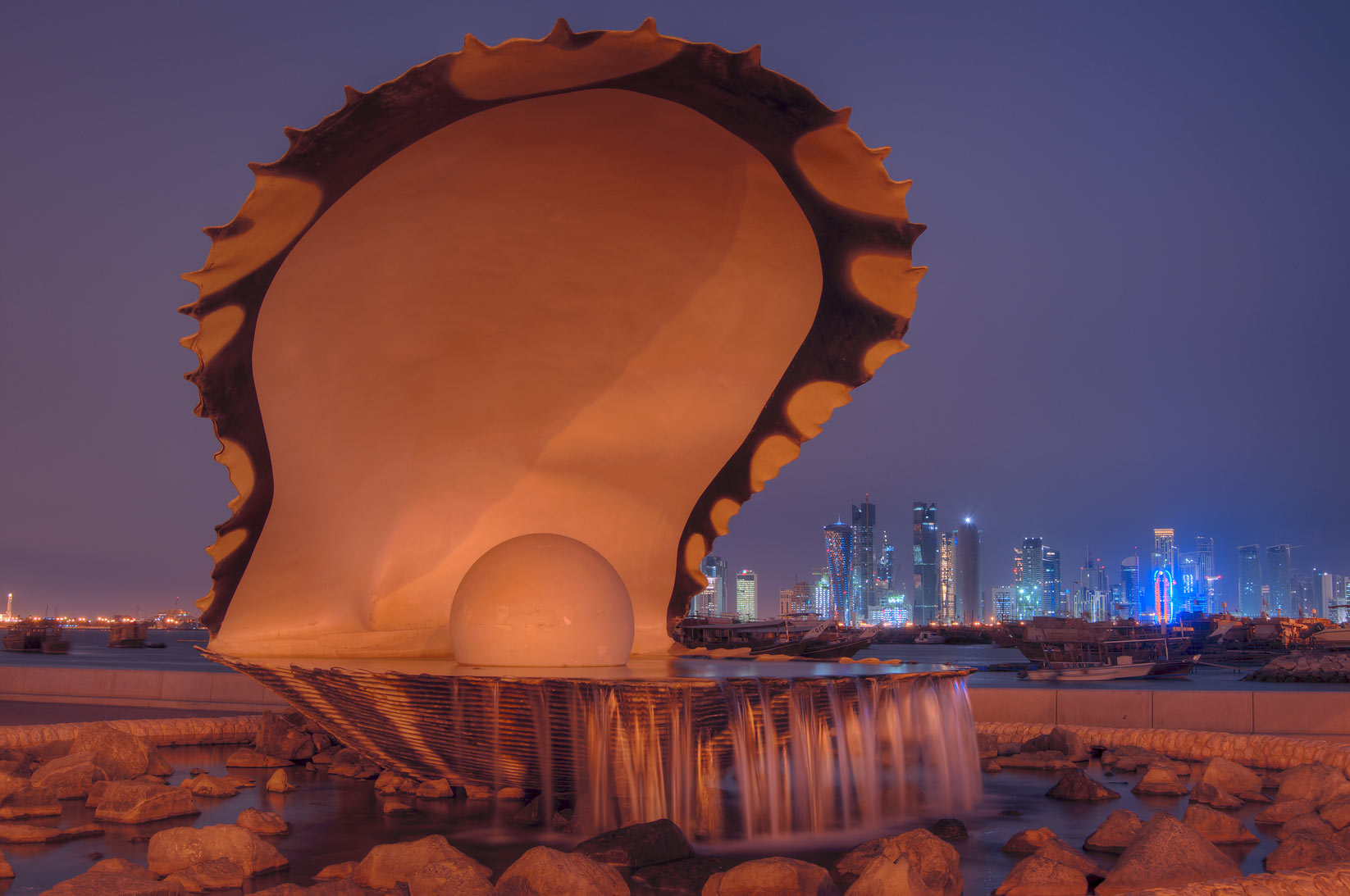 Oyster and Pearl Sculpture fountain on Corniche, with lights turned off. Doha, Qatar