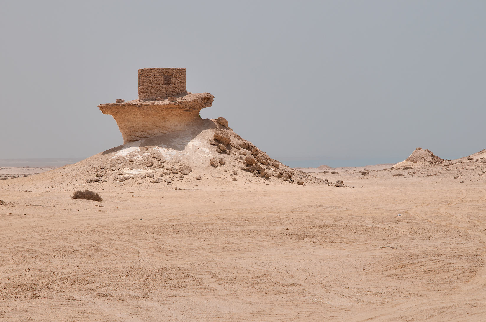 Stone hut nestling on a limestone hill remained...area, north from Zekreet. Qatar