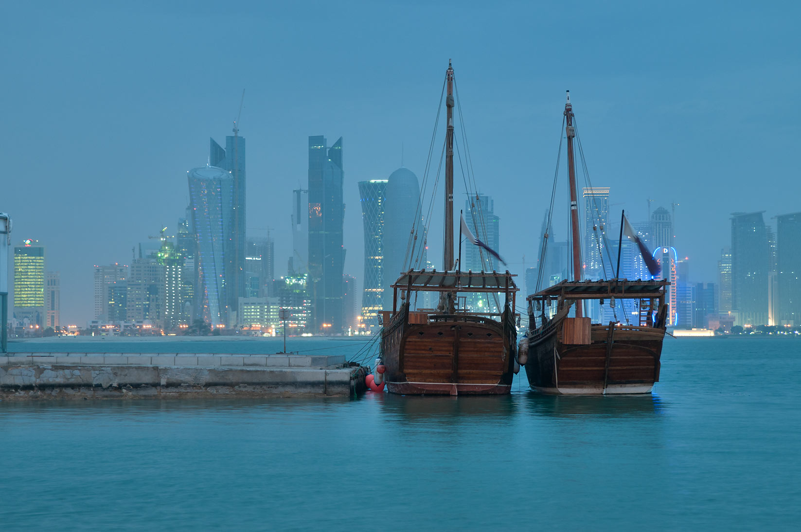 Dhow boats from Corniche, with West Bay in background. Doha, Qatar