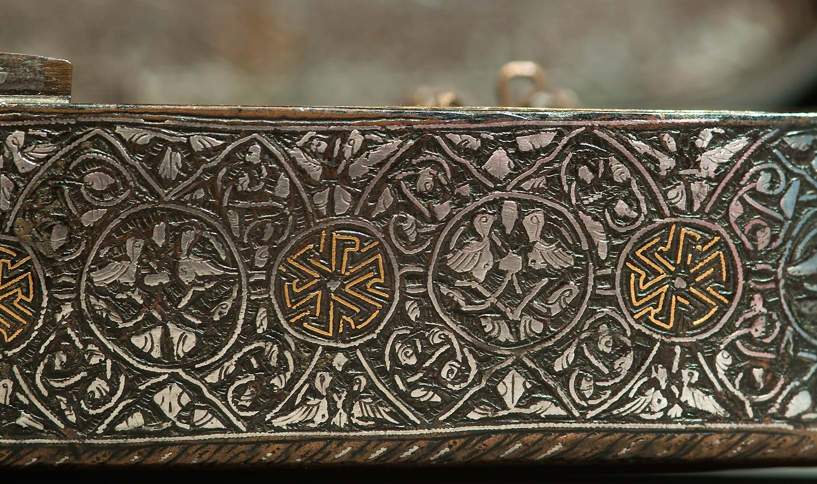 Pen case (Syria, 14th century, brass) on display in Museum of Islamic Art. Doha, Qatar