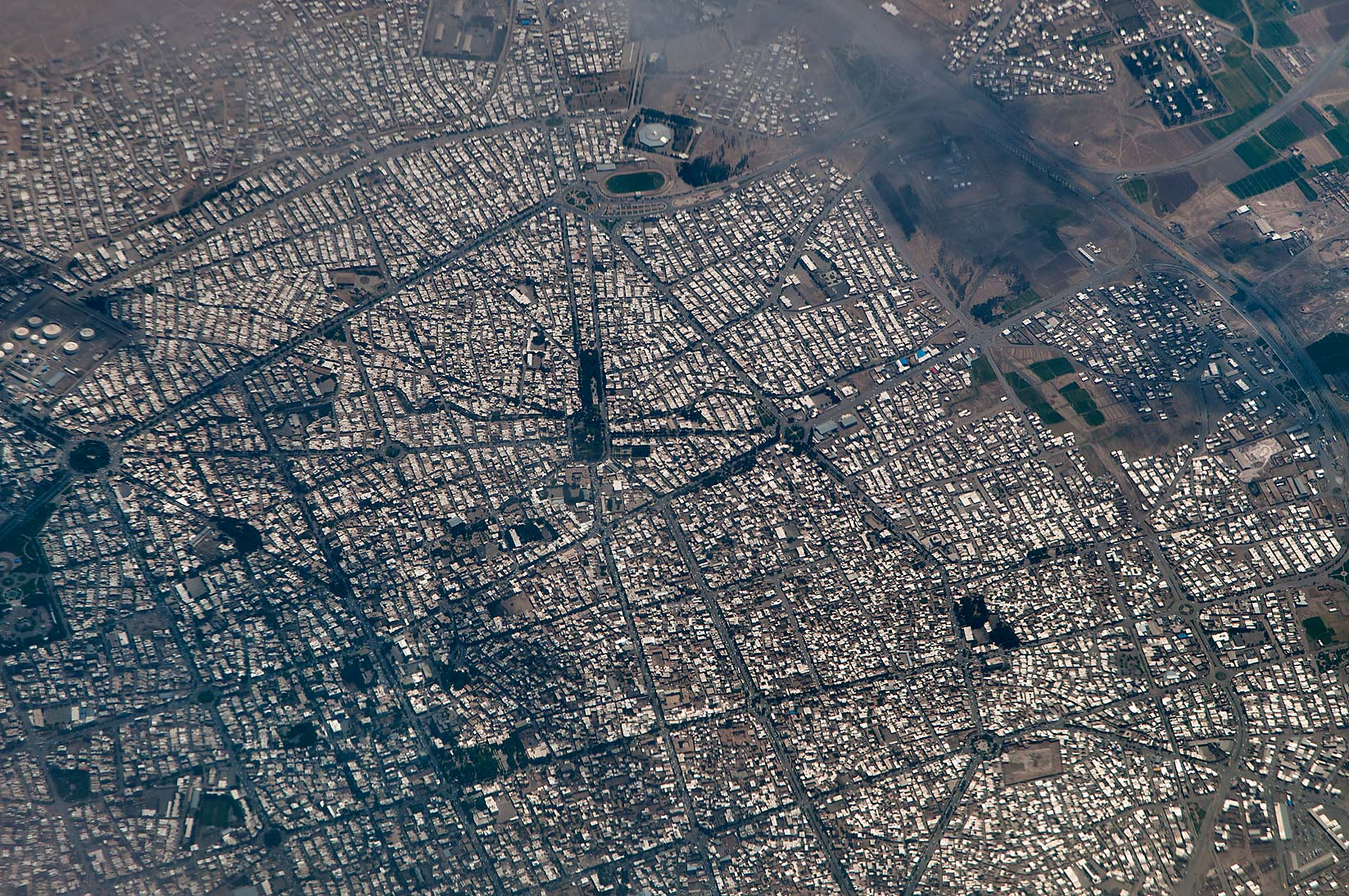A city in Iran, near Mashhad. View from a window of a plane from Dubai, UAE to Houston, TX
