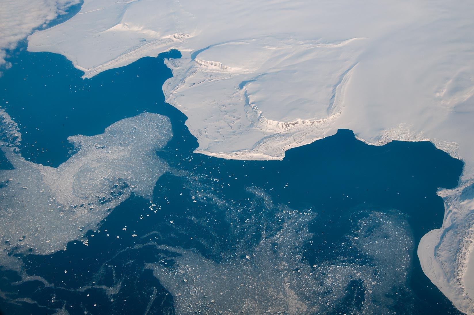 Ice on northern tip of Severny Island of Novaya...a plane from Dubai, UAE to Houston, TX