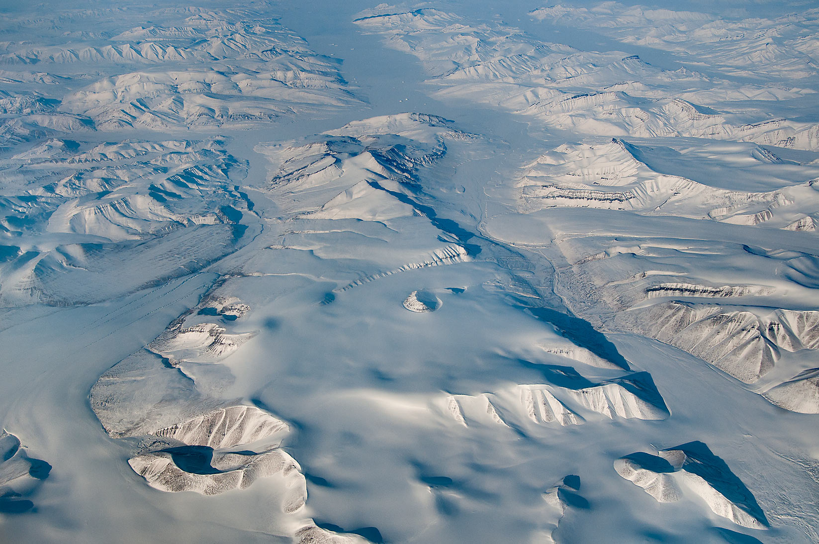Glaciers and fjords of Ellesmere Island, Canada...a plane from Dubai, UAE to Houston, TX