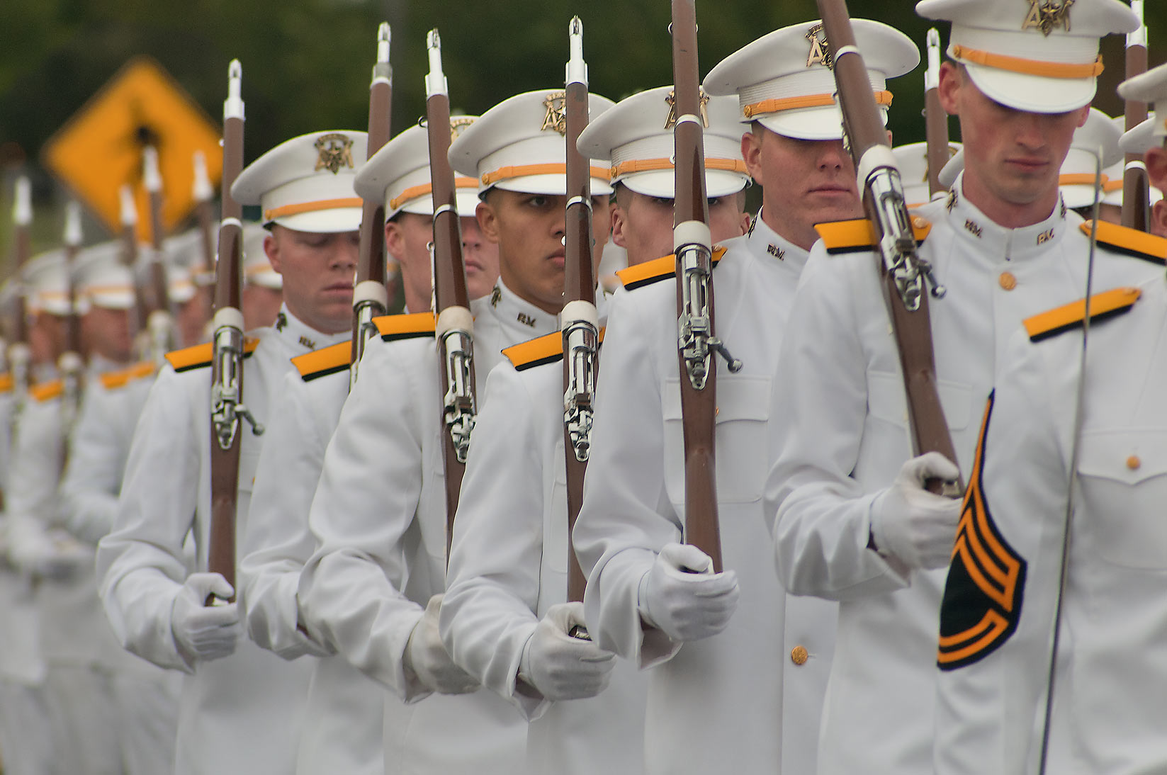 Marching cadets with guns during Christmas Parade...University Dr.. College Station, Texas