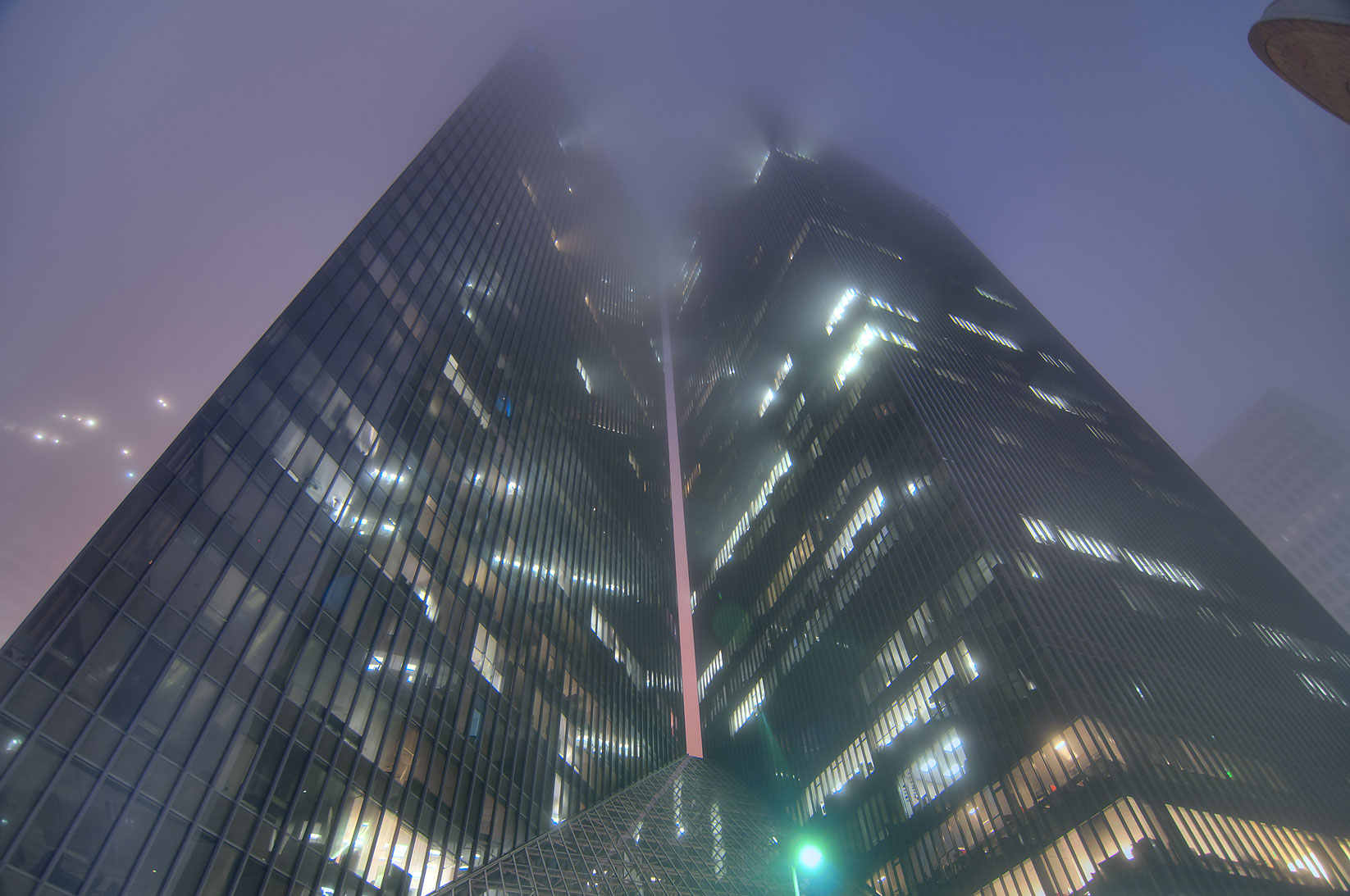 Pennzoil Place in downtown in fog at morning dusk. Houston, Texas
