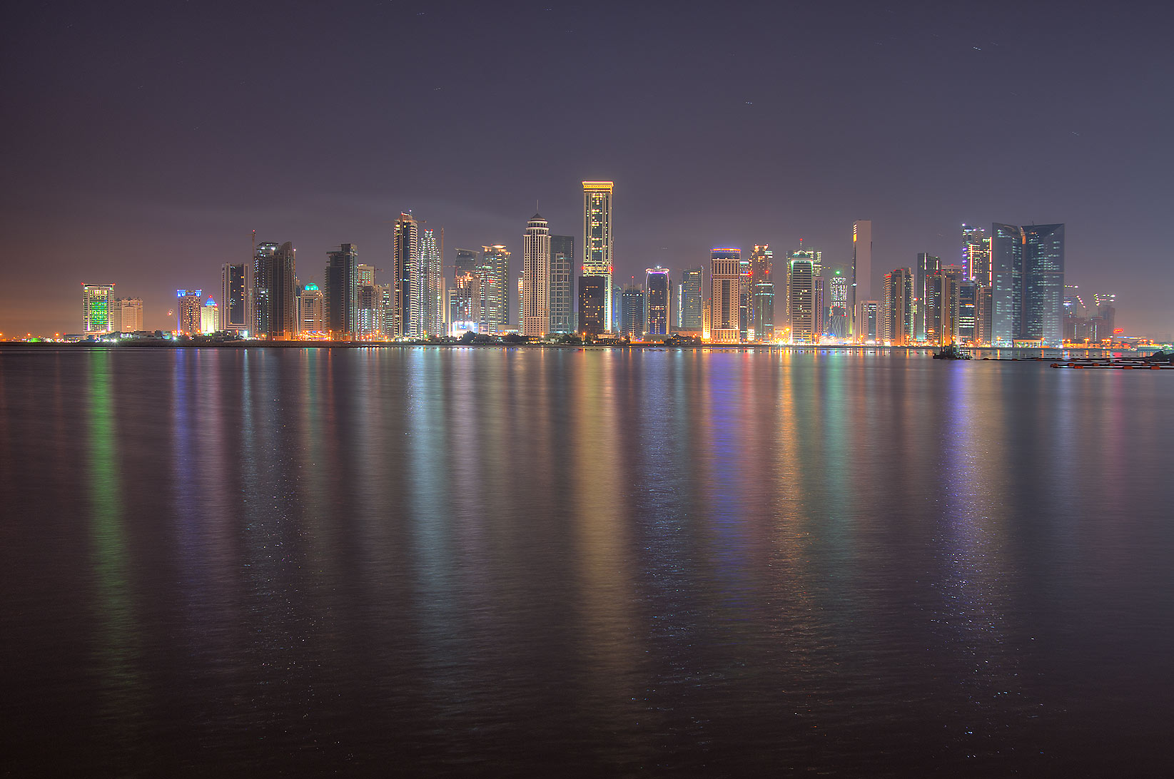 Reflections of West Bay from a beach near...Hotel before sunrise. Doha, Qatar