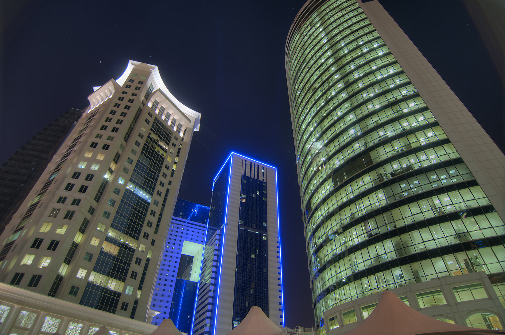 Al Qassar, Ezdan Hotel, and Olympic Tower in West Bay. Doha, Qatar