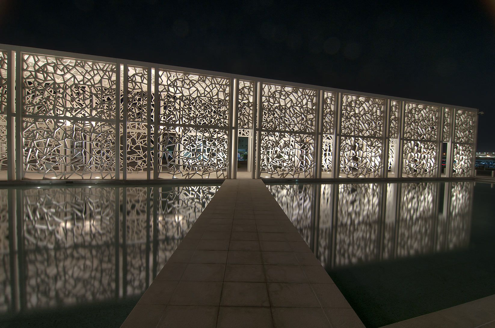 Illuminated walkway and a reflecting pool of...campus of Education City. Doha, Qatar